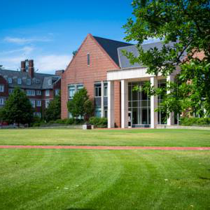 Green grass and view of the front of the Barlett Center